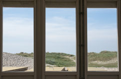 Beach. View through glass window Stock Photography