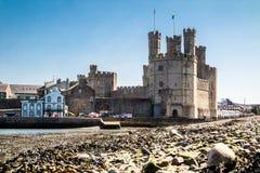 Beach view of the historic castle Caernafon, Gwynedd in Wales - United Kingdom.  stock image