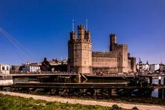 Beach view of the historic castle Caernafon, Gwynedd in Wales - United Kingdom.  royalty free stock image