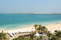 Beach with a view on Jumeirah Palm man-made island Royalty Free Stock Images