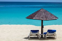 Beach view with ocean. Paradise beach view with ocean umbrella and beds Royalty Free Stock Photos