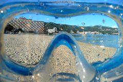 Beach view through a snorkel mask. Looking at a beach through a wet snorkel mask Stock Images