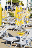 Beach view  with sunbeds and parasols on white sandy beach Royalty Free Stock Images