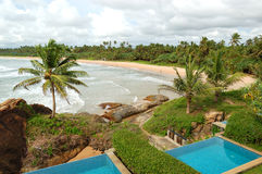 Beach view swimming pools at luxury villas Stock Photo