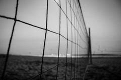 Volleyball net. Beach view. Volleyball net on the beach. Black and White. Costa del Sol, Andalusia, Spain royalty free stock photo