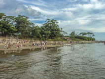 Beach View from the Water. CANELONES, URUGUAY, FEBRAURY - 2015 - Cloudy summer day view of leafy nature and the beach in Atlantida, one of the most famous Royalty Free Stock Photo