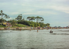 Beach View from the Water. CANELONES, URUGUAY, FEBRAURY - 2015 - Cloudy summer day view of leafy nature and the beach in Atlantida, one of the most famous Stock Images