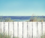 Beach View and White Fence Royalty Free Stock Image