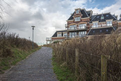 Beach villa Domburg, Netherlands. Villa in the dunes near the sea and a path leading to the beach Stock Image