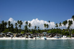 Beach village. Busy beach village with sea gipst settler stock photo