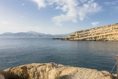 Matala Beach. Beach in the village Matala , Crete , Greece , Europe . At eveniing time Stock Photo