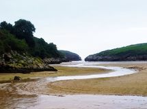Beach village of Poo in Asturia. Beach village of Poo in  Asturias. The river flows into the ocean Stock Photos