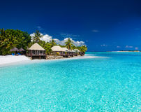Beach Villas on small tropical island Stock Photography