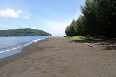 Beach with volcanic sand Stock Photo