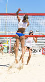 Beach volley  championchip (rome). Woman jump to crush the ball at the point of victory - the final showdown Royalty Free Stock Images