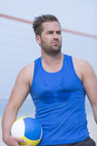 Beach volley male player and ball Royalty Free Stock Photos
