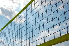 Beach volley net. In front of cloudy sky Stock Photos