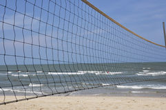 Beach volley net on a windy beach stock images