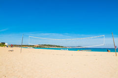 Beach volley net and rubber boats in Porto Pollo Royalty Free Stock Photo