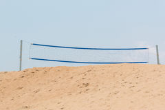 Beach volley net on sand dune with sky. Royalty Free Stock Photography