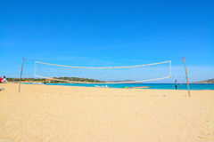 Beach volley net and surfboards Stock Photography