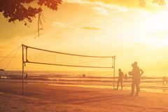 Beach volley at sunset. Beach volleyball Is a popular sport that is played on the beach and playground sand royalty free stock photos
