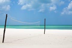 Beach Volleyball. A beach volleyball net on a white sandy beach Stock Photo