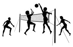 Beach volleyball. Editable vector silhouettes of women playing beach volleyball with women and net as separate objects Stock Images