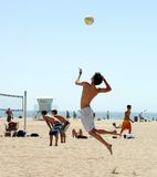 Beach Volleyball. High Flying Serve In Beach Volleyball Match Royalty Free Stock Photos