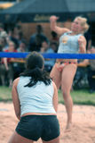 Beach volleyball. Players in action Stock Photos