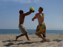 Beach Volleyball. 2 men playing volleyball on the beach Royalty Free Stock Images