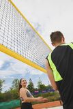 Beach volleyball amateur players in action. At summer day under sky royalty free stock photo