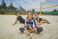 Beach volleyball amateur players. Happy after the game at summer day under sky stock images