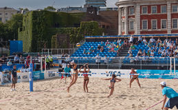 Beach Volleyball at Horse Guards Parade. Great Britain and USA team members from left to right, Heather Lowe, Tealle Hunkus, Lucy Boulton and Denise Johns Stock Images