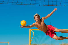 Beach volleyball - man jumping royalty free stock photography