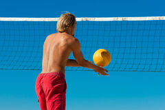 Beach volleyball - man serving the ball Stock Photo