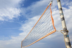 Beach volleyball net. A beach volleyball net in sunny day over blue cloudy sky Royalty Free Stock Image