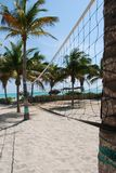 Beach volleyball net. Sand and palms Stock Photo
