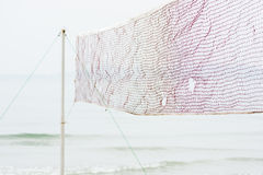Beach volleyball net on beach Stock Images