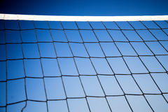 Beach volleyball net with a blue sky Stock Images