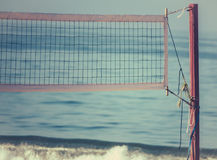 Beach Volleyball Net With Ocean in Background. Volleyball Net on the Beach at Sunrise With Ocean in Background Stock Images