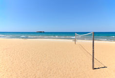 Beach Volleyball net on sandy beach with sea. And blue sky in the background Royalty Free Stock Photos