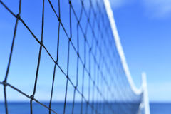 Beach volleyball net with selective focus Stock Images