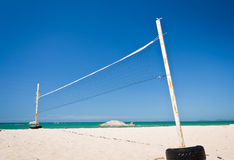 A beach volleyball net on a sunny day Stock Photos
