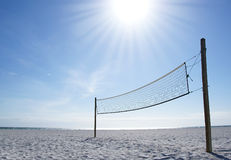 Beach volleyball net on a sunny day. A beach volleyball net on a sunny day, on an empty beach Royalty Free Stock Images