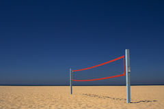 Beach Volleyball Net Under a Blue Sky royalty free stock image