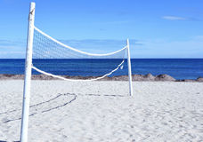Beach volleyball net with white sand Stock Images