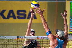 Beach volleyball - over the net. Alison Cerutti from Brasil and Jacob Gibb from USA over the net in the swatch beach volleyball world tour tournament in Prague royalty free stock images