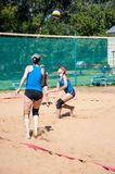 Beach volleyball play girls Royalty Free Stock Image