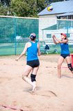 Beach volleyball play girls Stock Images